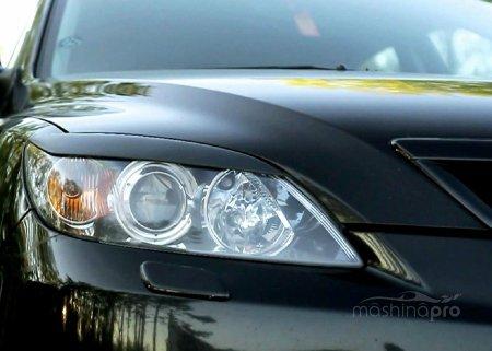 Система очистки оптики на автомобилях Mazda