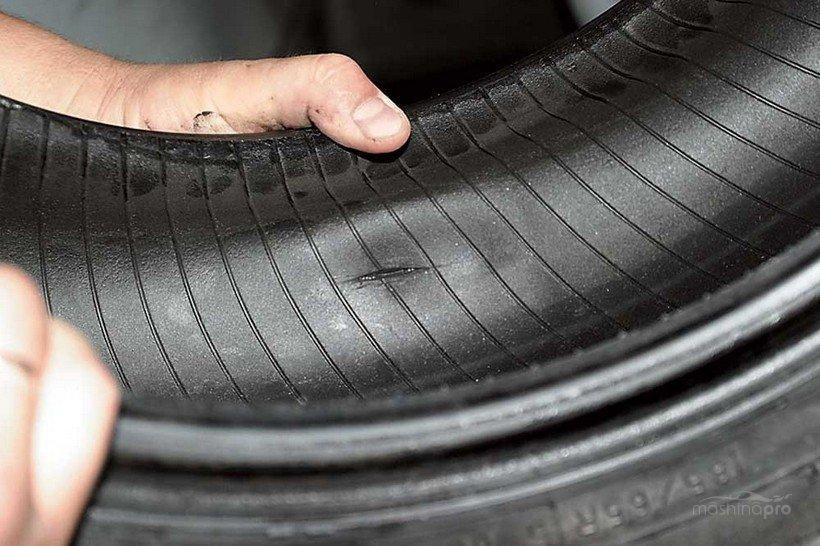 Продольный порез шины автомобиля